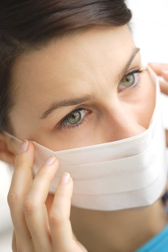 Stock Photo: 4269-2415 Woman wearing a protective mask.