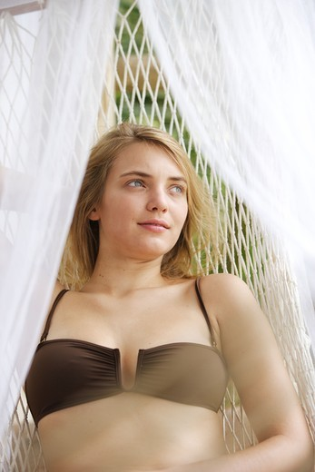 Woman under a mosquito net. : Stock Photo