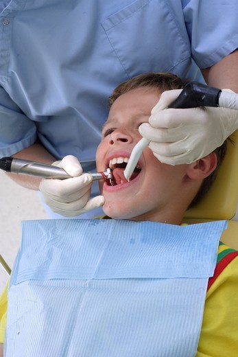 8 years old child at the dentist. : Stock Photo