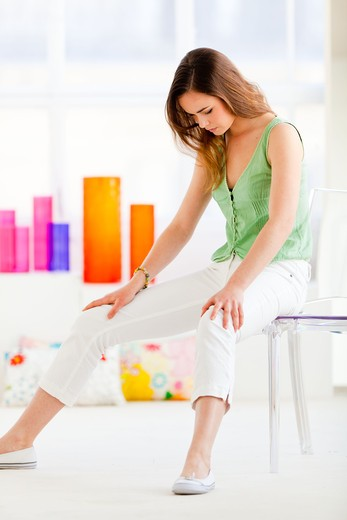 Gymnastic exercise to tone and build muscles at home. : Stock Photo