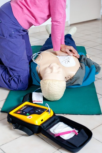 Stock Photo: 4269-29818 First aid training courses given by the French Red Cross. Portable semi-automatic heart defibrillator used on a mannequin.