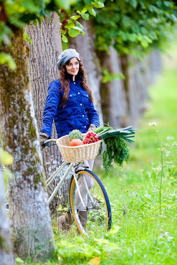 Stock Photo: 4269-30160 Woman riding her bike.