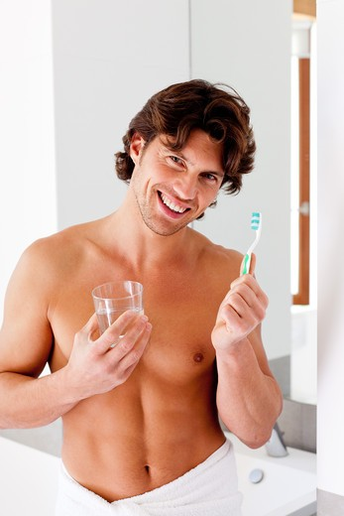 Man. Man brushing her teeth. : Stock Photo