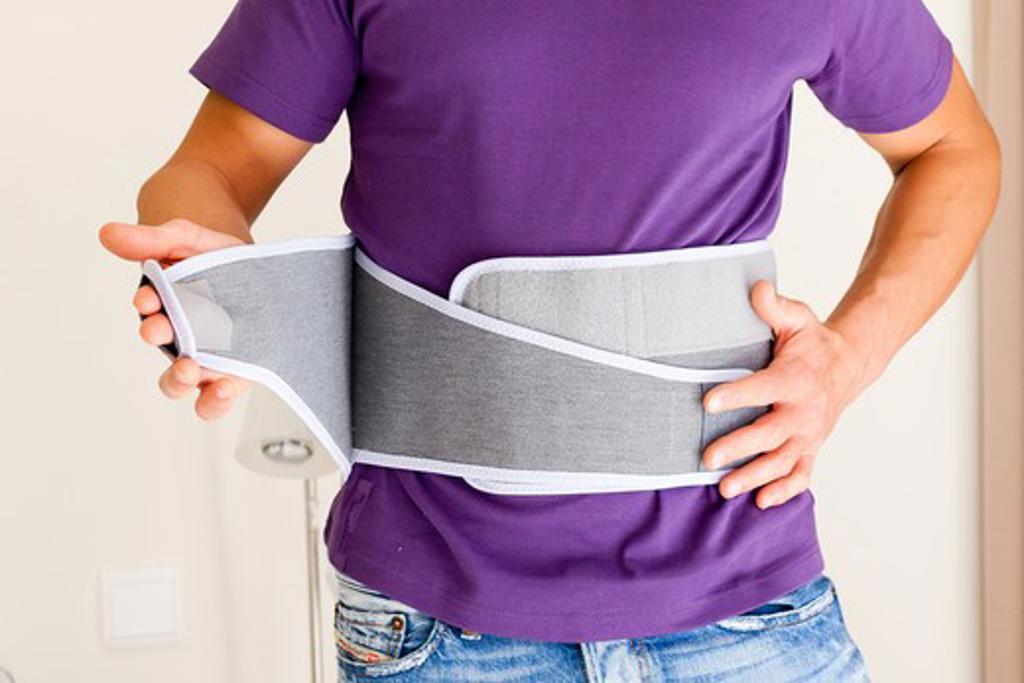 Lifting belt. Lifting belt used to prevent lumbar pain. : Stock Photo