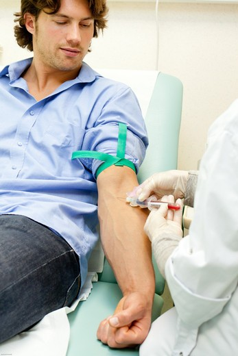 Blood sample. Man having a blood sample. : Stock Photo