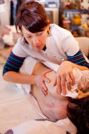 Stock Photo: 4269-31335 Physiotherapy session at the home of a woman dying, suffering from multiple sclerosis.