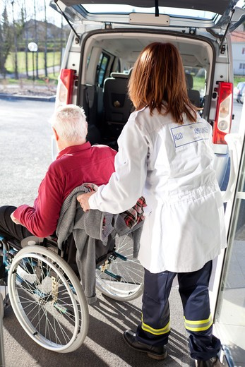 Stock Photo: 4269-31379 Ambulance transport from home to office physical therapy for an elderly man with diabetes who underwent a leg amputation.