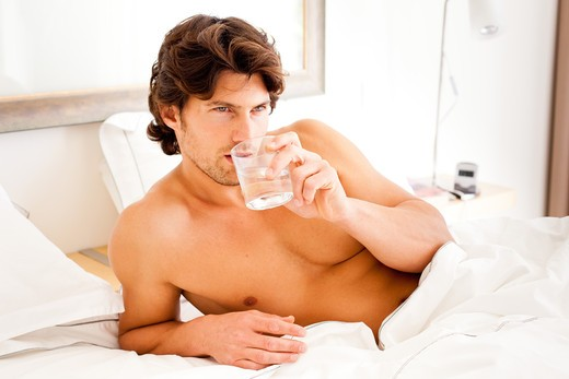 Stock Photo: 4269-31568 Man drinking glass of water.