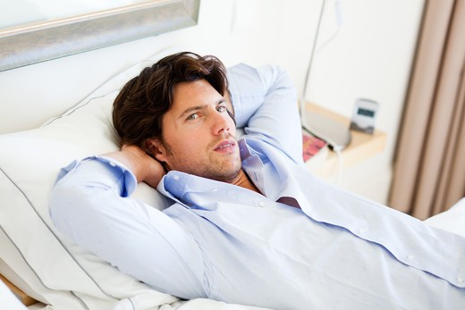 Man relaxing on couch. : Stock Photo
