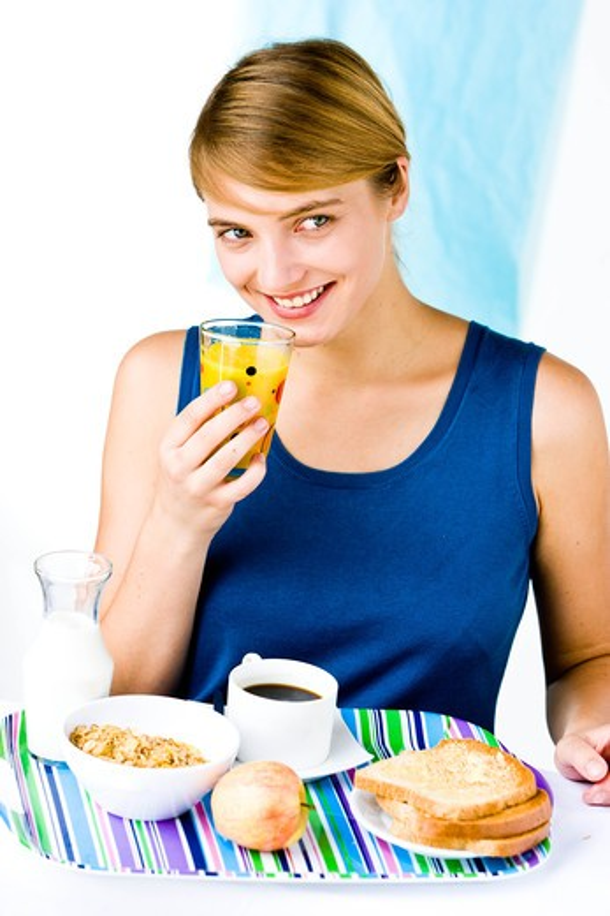 Stock Photo: 4269-31756 woman having breakfast.