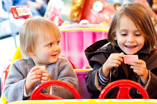Stock Photo: 4269-32139 Children on a merry-go-round.