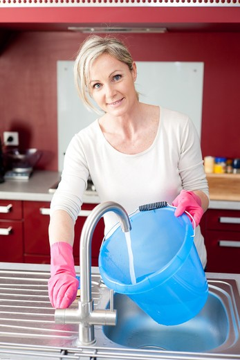 Stock Photo: 4269-33195 woman house cleaning.
