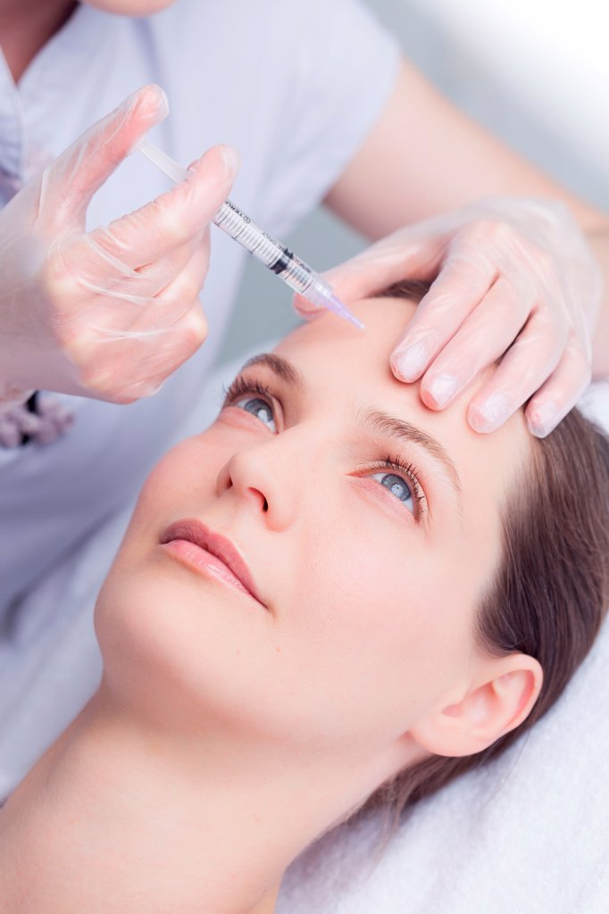 Woman receiving injections for treatment of wrinkles. : Stock Photo
