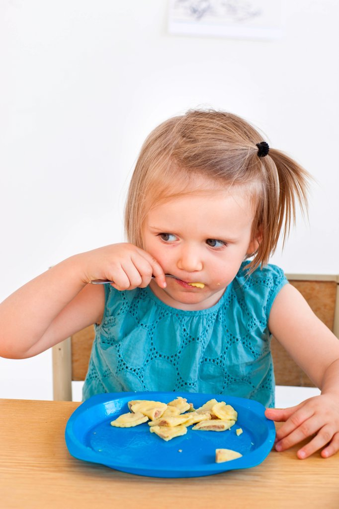 Stock Photo: 4269-34222 2 years old girl eating.