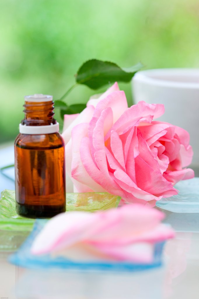 Rose essential oil. : Stock Photo