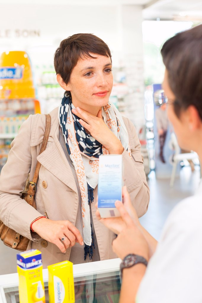 Stock Photo: 4269-34954 Woman purchasing drugs for sorethroat