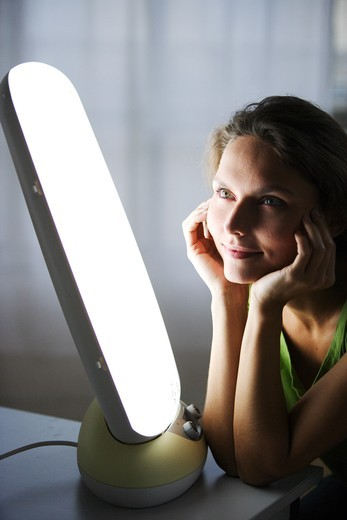 Light therapy, or phototherapy : treatment of depression with light. : Stock Photo