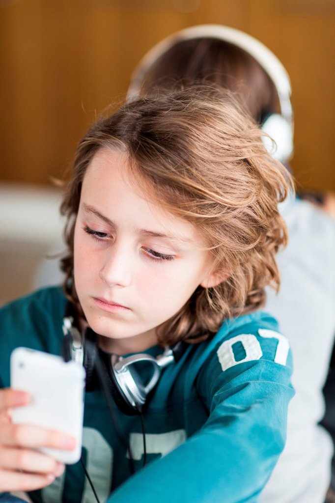 Stock Photo: 4269-35097 Teenagers using smartphone
