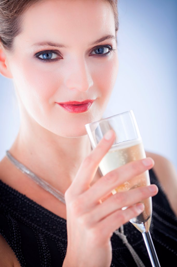 Stock Photo: 4269-35148 Woman drinking champagne
