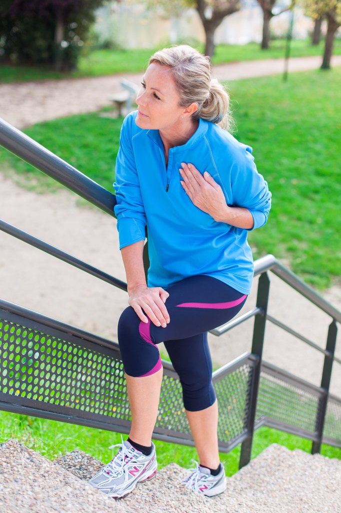 Woman out of breath because of physical activity : Stock Photo