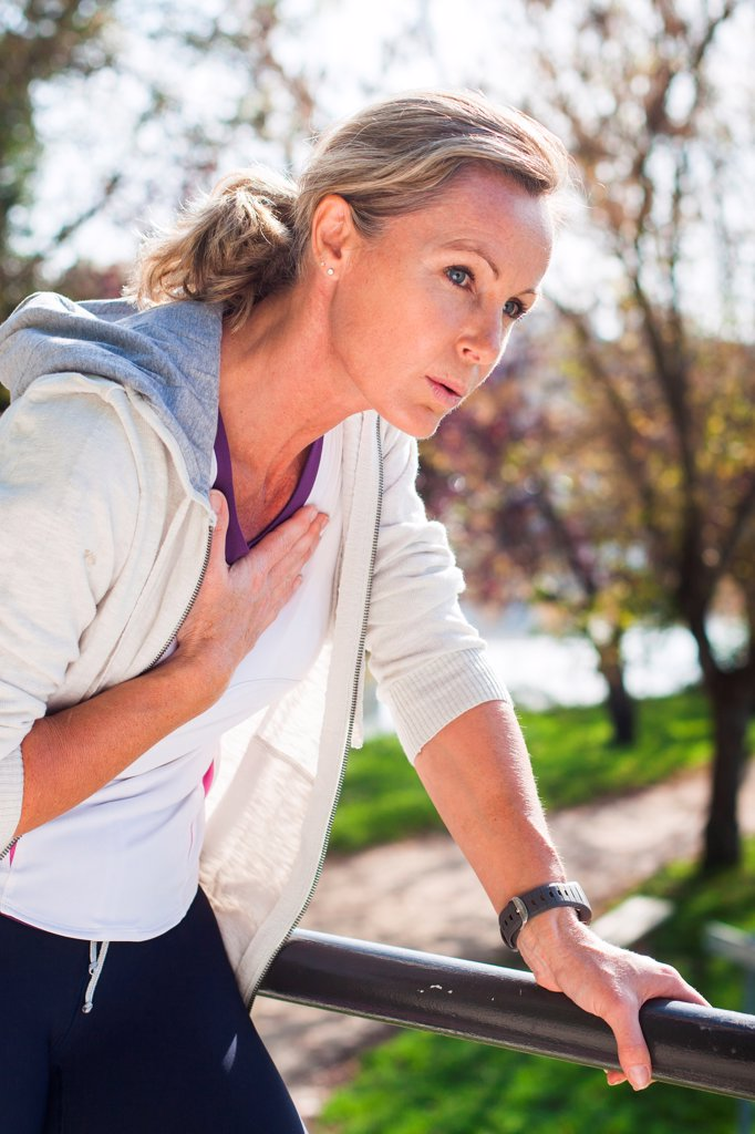 Stock Photo: 4269-35757 Woman out of breath because of physical activity