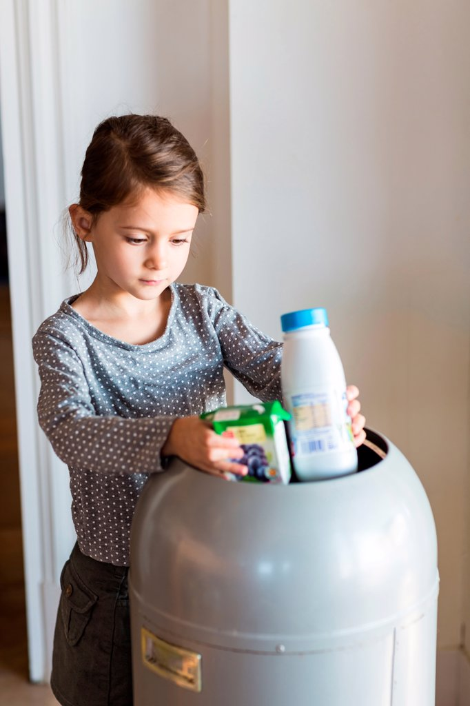 Girl sorting recycled wastes : Stock Photo