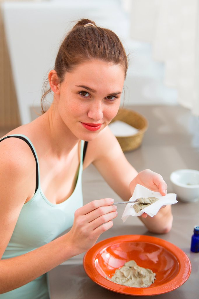 Stock Photo: 4269-36433 Woman preparing a poultice with green clay