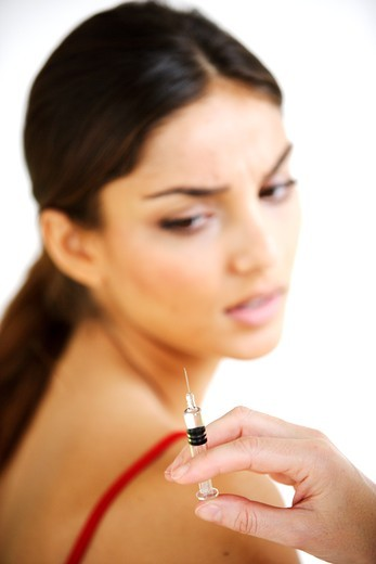 Stock Photo: 4269-3998 Woman receiving vaccination.