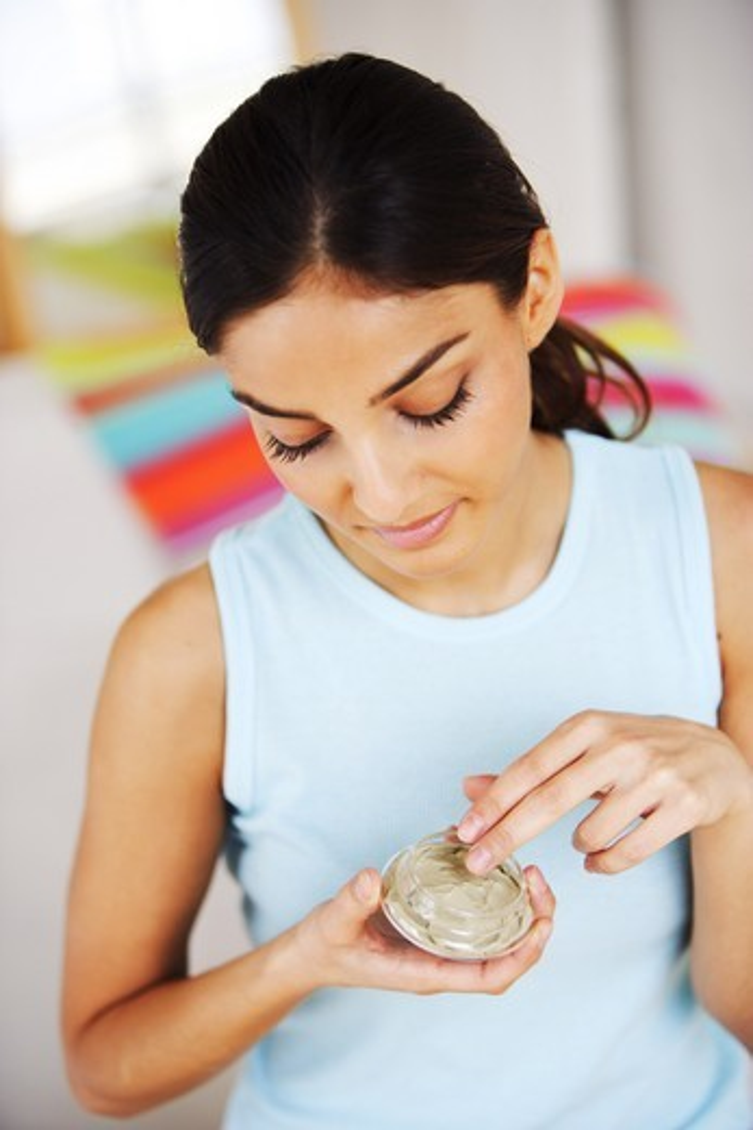 Woman preparing clay beauty mask. : Stock Photo