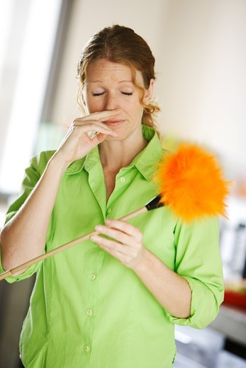 Stock Photo: 4269-4233 Woman sneezing from dust.