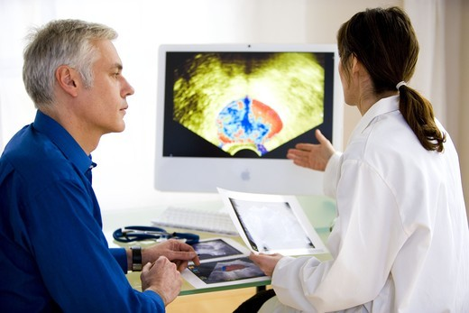 Doctor discussing prostate ultrasound scan with a patient. : Stock Photo