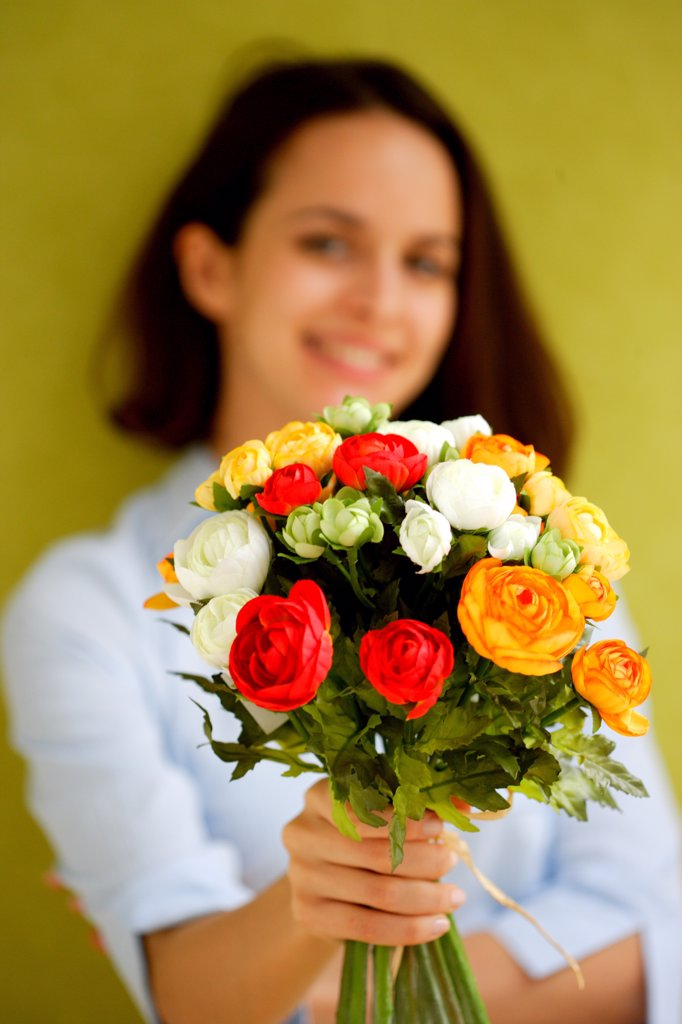 Woman holding bunch of flowers. : Stock Photo