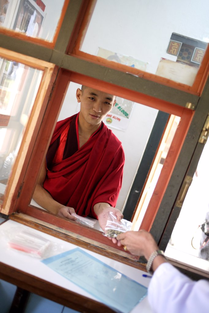 Department of traditional medicine, Thimphu hospital, Bhutan. A patient is given traditional medicine, mainly made of medicinal plants, at the hospital pharmacy. : Stock Photo