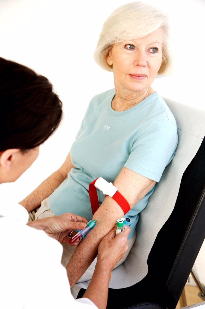 Stock Photo: 4269-5382 Elderly woman having blood sample.