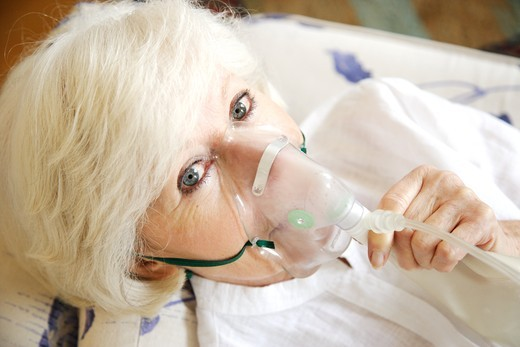 Stock Photo: 4269-5921 Elderly woman with oxygen mask for oxygenotherapy.