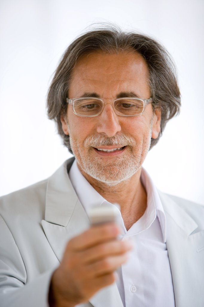 Stock Photo: 4269-6208 Man using cell phone.