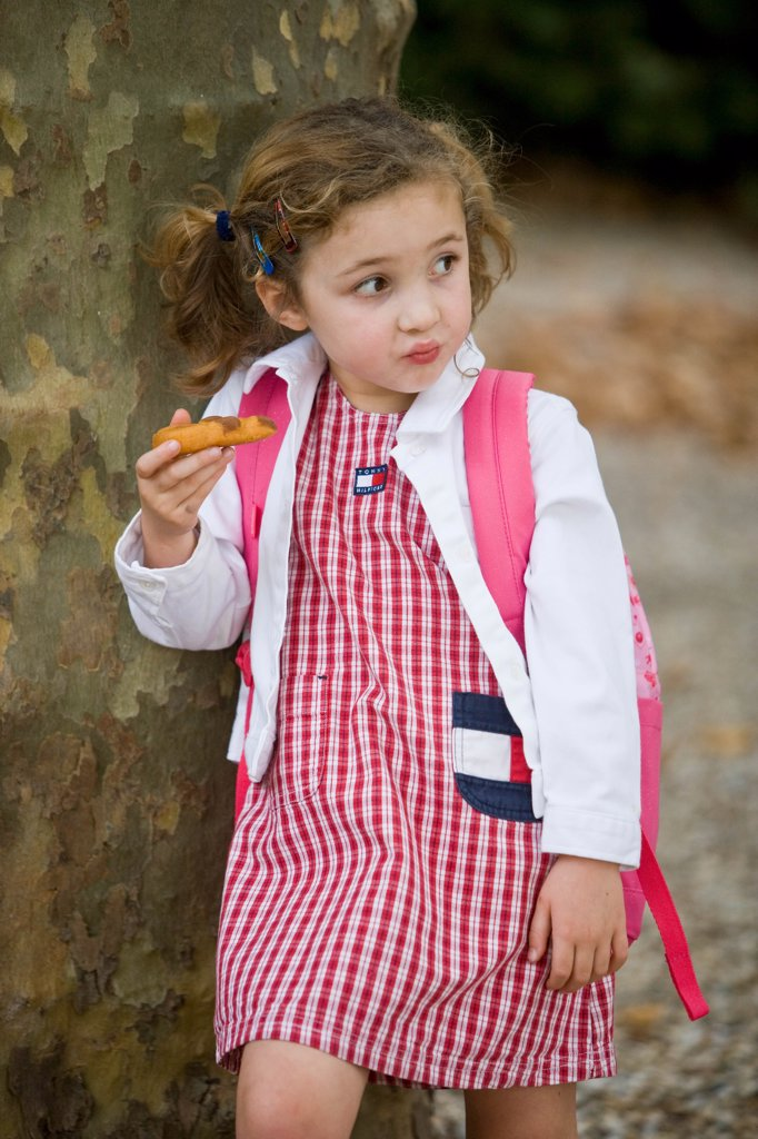 Stock Photo: 4269-6951 5 years old girl eating a snack.