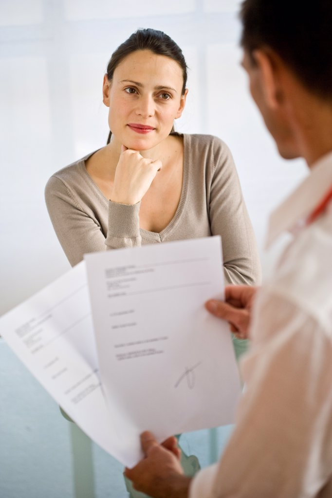 Doctor giving a patient medical prescriptions. : Stock Photo