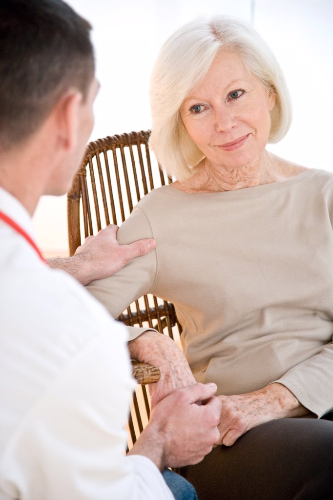 Doctor talking with elderly woman. : Stock Photo