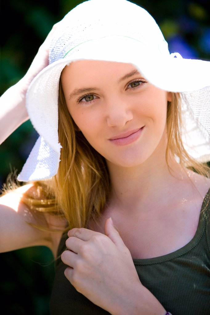 Young woman with hat. : Stock Photo