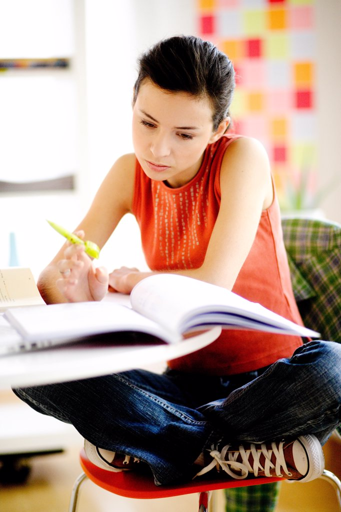Stock Photo: 4269-8826 Student revising exams.