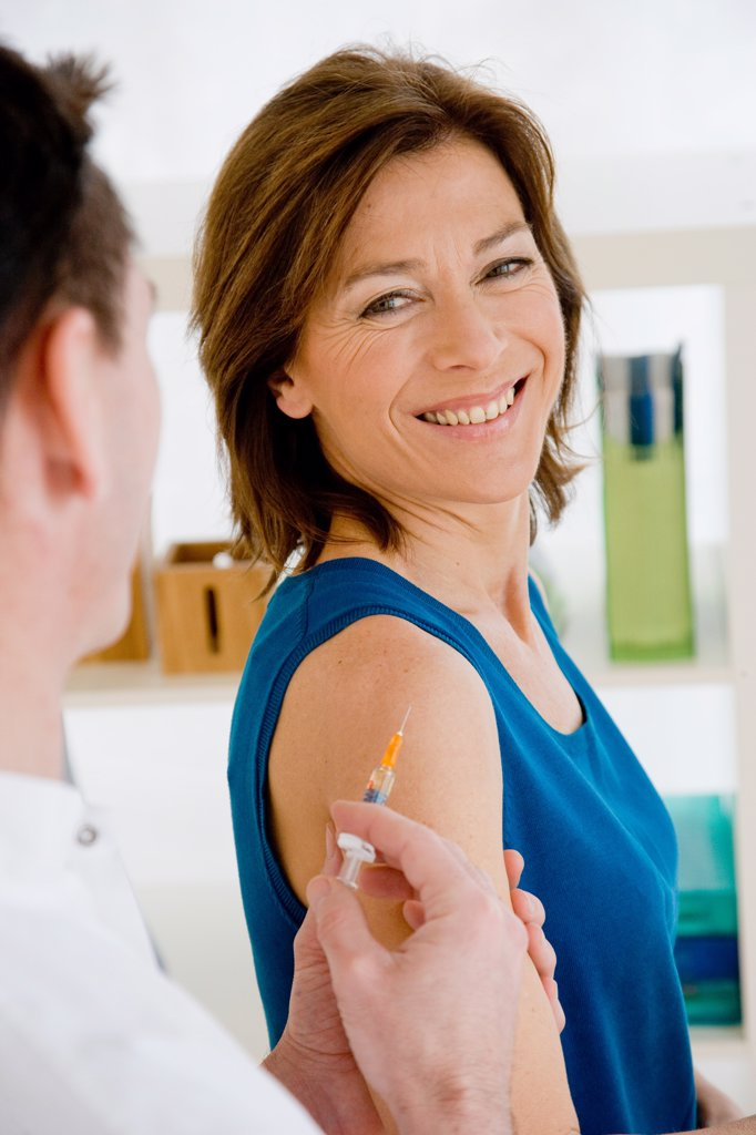 Stock Photo: 4269-9258 Woman receiving vaccination.