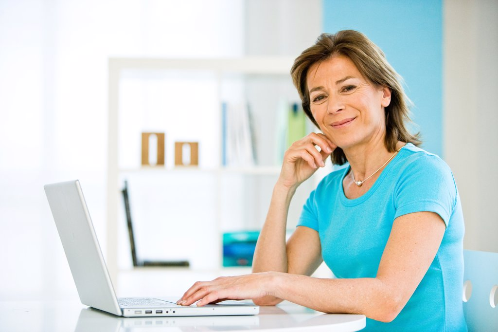 Woman using laptop computer. : Stock Photo