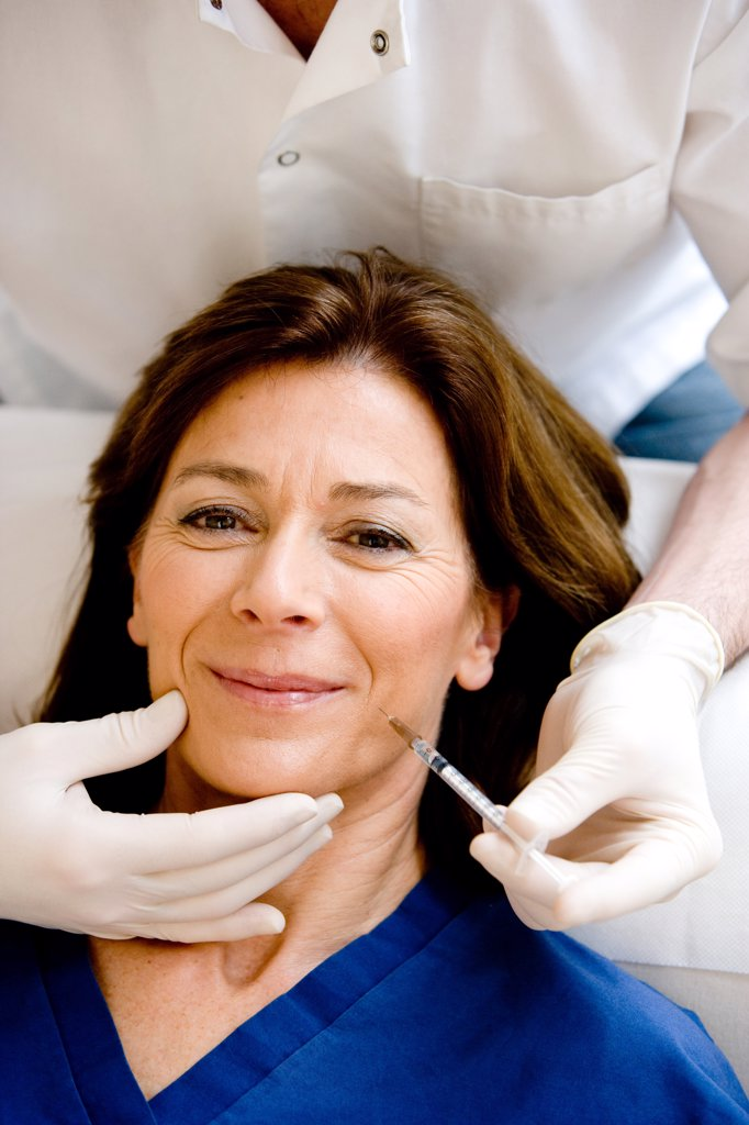 Stock Photo: 4269-9322 Treatment of wrinkles with Botox injections.