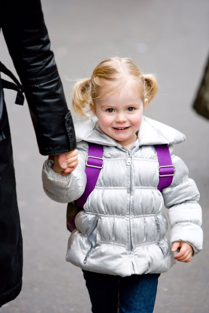 3 years old girl on her way to school. : Stock Photo