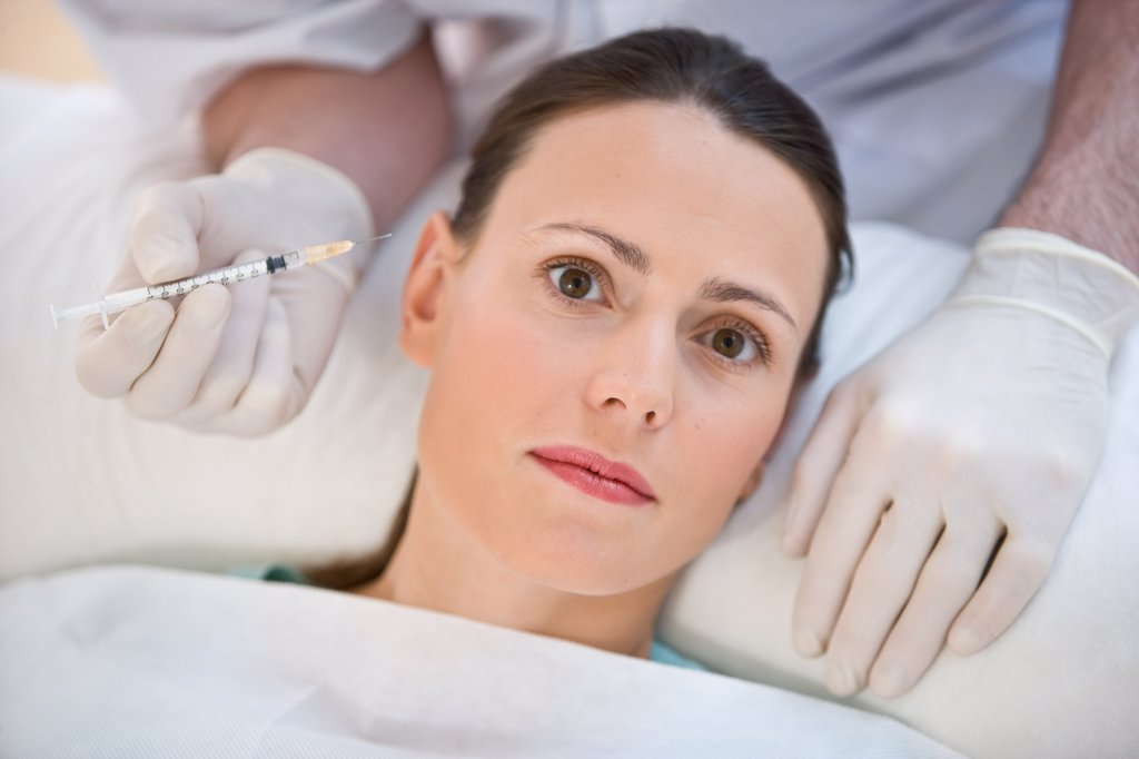 Woman receiving Botox injections for treatment of wrinkles. : Stock Photo