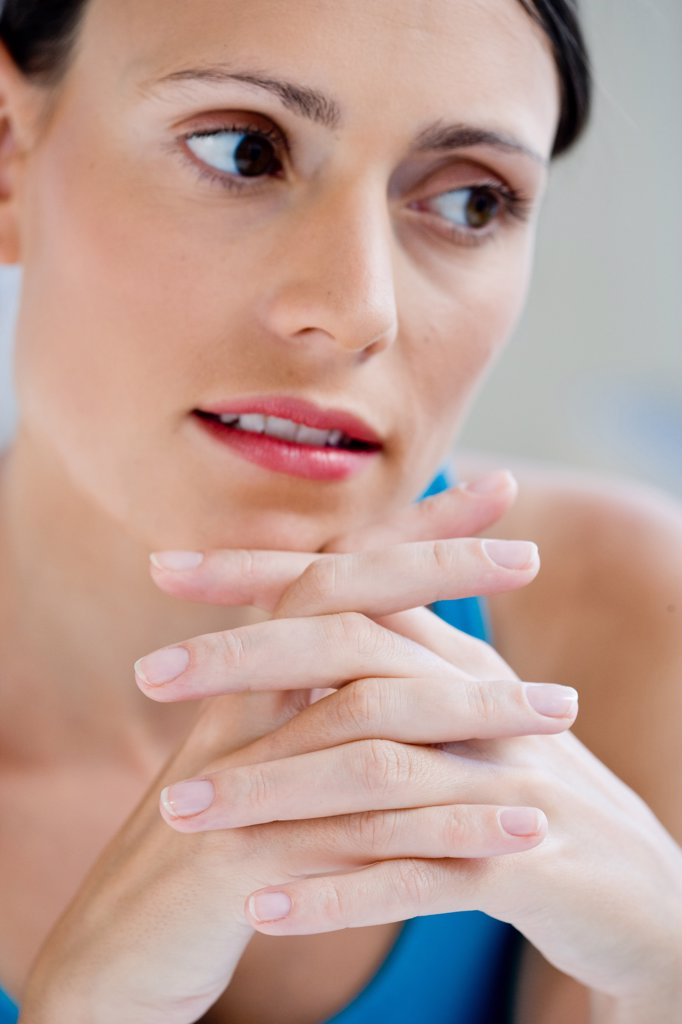 Stock Photo: 4269-9588 Portrait of woman with fingers crossed.