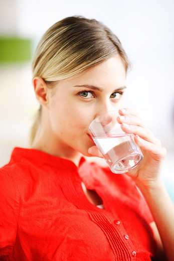 Woman drinking a glass of water. : Stock Photo