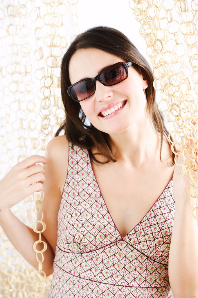 Stock Photo: 4269-9824 Portrait of woman with sunglasses.
