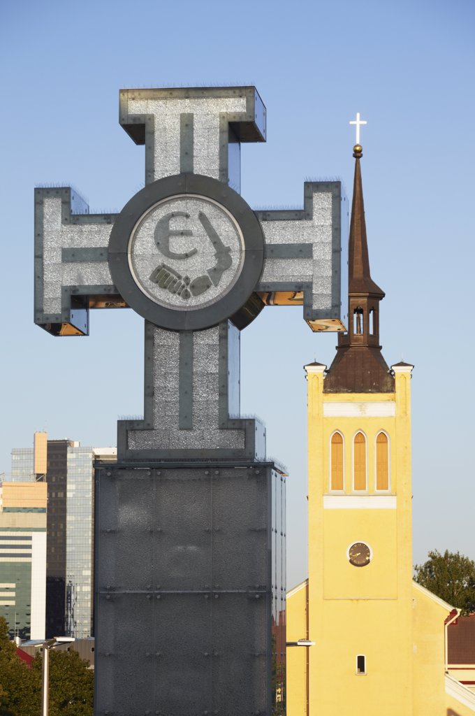 Stock Photo: 4272-10002 Estonia, Tallinn, Cross In Freedom Square With St John's Church (Jaani Kirik) In Background
